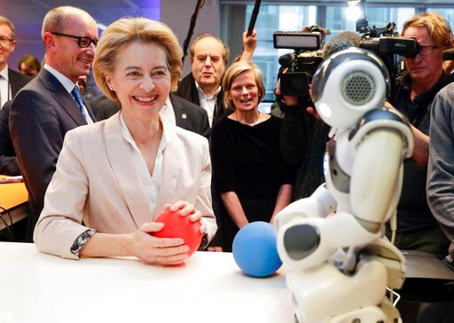 (Stephanie Lecocq, Pool Photo via AP). President of the European Commission Ursula von der Leyen looks at the invention 'Do you Speak Robot?' at the AI Xperience Center at the VUB (Vrije Universiteit Brussel) in Brussels, Tuesday, Feb. 18. 2020.