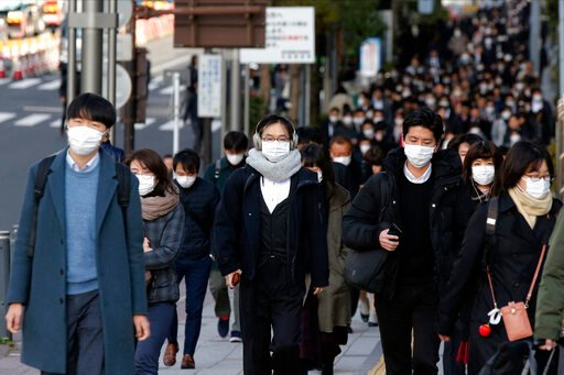 (AP Photo/Kiichiro Sato). People wear masks as they commute during the morning rush hour Thursday, Feb. 20, 2020, in Chuo district in Tokyo. A viral outbreak that began in China has infected more than 75,000 people globally. More than 1,000 cases have ...