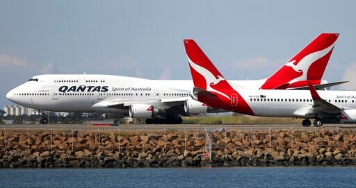 (AP Photo/Rick Rycroft, File). FILE - In this Aug. 20, 2015 file photo, two Qantas planes taxi on the runway at Sydney Airport in Sydney, Australia. Some Asian airlines have rerouted flights to the Middle East to avoid Iranian airspace, amid escalated ...