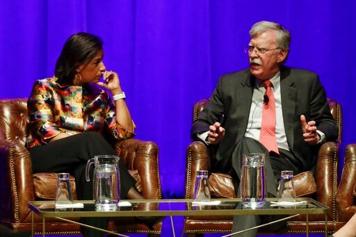(AP Photo/Mark Humphrey). Former national security advisers Susan Rice, left, and John Bolton take part in a discussion on global leadership at Vanderbilt University, Wednesday, Feb. 19, 2020, in Nashville, Tenn.