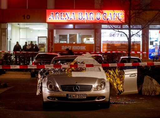 (AP Photo/Michael Probst). A car with dead bodies stands in front of a bar in Hanau, Germany, Thursday, Feb. 20, 2020. German police say several people were shot to death in the city of Hanau on Wednesday evening.