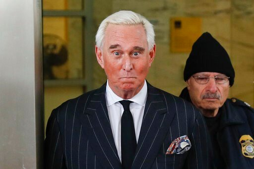 (AP Photo/Pablo Martinez Monsivais). FILE - In this Feb. 1, 2019 file photo, former campaign adviser for President Donald Trump, Roger Stone, leaves federal court in Washington. The Justice Department said Tuesday it will take the extraordinary step of...