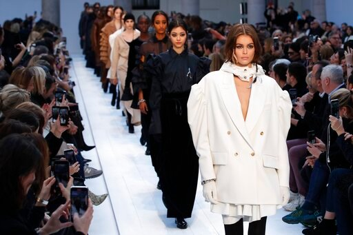 (AP Photo/Antonio Calanni). Model Kaia Gerber wears a creation as part of Max Mara's Fall/Winter 2020/2021 collection, presented in Milan, Italy, Thursday, Feb. 20, 2020.