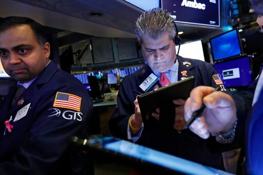 (AP Photo/Richard Drew, File). FILE - In this Feb. 5, 2020, file photo specialist Dilip Patel, left, and trader John Panin work on the floor of the New York Stock Exchange. The U.S. stock market opens at 9:30 a.m. EST on Thursday, Feb. 20.