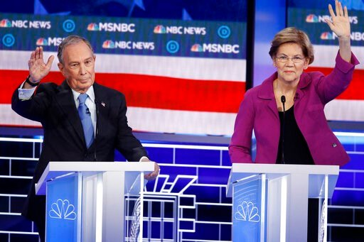 (AP Photo/John Locher). Democratic presidential candidates, former New York City Mayor Mike Bloomberg, left, and Sen. Elizabeth Warren, D-Mass., try to answer a question during a Democratic presidential primary debate Wednesday, Feb. 19, 2020, in Las V...