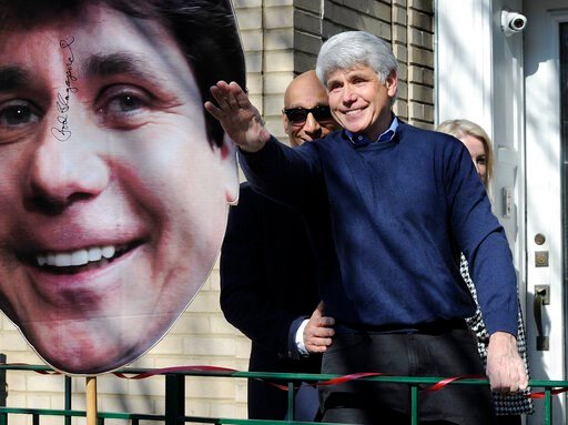 (Mark Welsh/Daily Herald via AP)/Daily Herald via AP). Former Illinois Gov. Rod Blagojevich waves to his friends after giving a press conference at his Chicago home on Wednesday, Feb. 19, 2020, one day after having his prison sentence commuted by Presi...