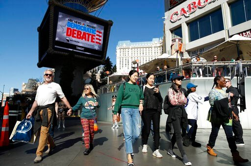 (AP Photo/John Locher). People walk near the Paris Las Vegas hotel casino, site of a Democratic presidential debate, Wednesday, Feb. 19, 2020, in Las Vegas. Nevada's first-in-the West presidential caucus puts the spotlight Saturday on a state that has ...