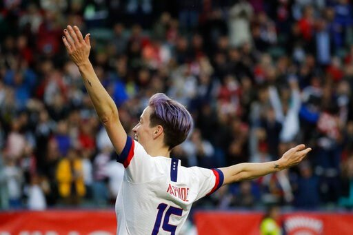 (AP Photo/Chris Carlson). U.S. forward Megan Rapinoe celebrates after scoring against Canada during the second half of a CONCACAF women's Olympic qualifying soccer match Sunday, Feb. 9, 2020, in Carson, Calif. The U.S. won 3-0.
