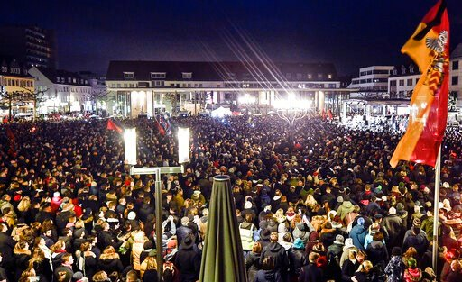 (AP Photo/Martin Meissner). Thousands listen to German president Frank-Walter Steinmeier during a vigil on the market place for the victims of the shooting in Hanau, Germany, Thursday, Feb. 20, 2020. A 43-year-old German man shot and killed several peo...