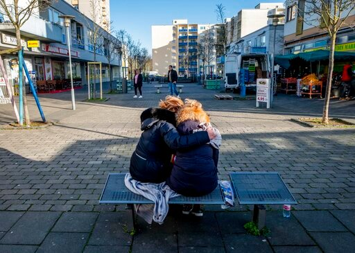 (AP Photo/Michael Probst). Two woman mourn near a kiosk in Hanau, Germany Friday, Feb. 21, 2020 two days after a 43-year-old German man shot and killed several people at several locations in a Frankfurt suburb on Wednesday, Feb. 19, 2020.