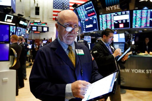 (AP Photo/Richard Drew, File). FILE - In this Feb. 6, 2020, file photo trader John Doyle works on the floor of the New York Stock Exchange. The U.S. stock market opens at 9:30 a.m. EST on Friday, Feb. 21.