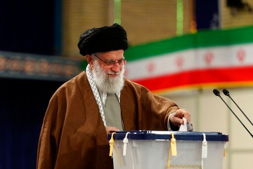 (Office of the Iranian Supreme Leader via AP). In this photo released by the official website of the office of the Iranian supreme leader, Supreme Leader Ayatollah Ali Khamenei casts his ballot in the parliamentary elections, in Tehran, Iran, Friday, F...