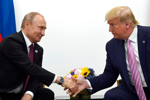 (AP Photo/Susan Walsh, File). FILE - In this June 28, 2019, file photo, President Donald Trump, right, shakes hands with Russian President Vladimir Putin, left, during a bilateral meeting on the sidelines of the G-20 summit in Osaka, Japan. Intelligenc...