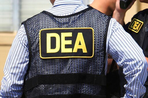 (Joe Burbank/Orlando Sentinel via AP, File). FILE - This June 13, 2016 file photo shows Drug Enforcement Administration (DEA) agents in Florida. On Friday, Feb. 21, 2020, the FBI arrested U.S. federal narcotics agent Jose Irizarry and his wife, Nathali...