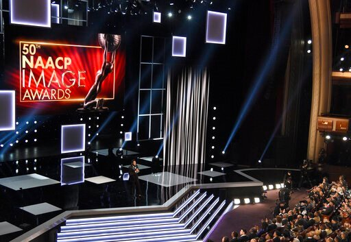 (Photo by Chris Pizzello/Invision/AP, File). FILE - In this March 30, 2019, file photo, host Anthony Anderson speaks at the 50th annual NAACP Image Awards on Saturday, March 30, 2019, at Dolby Theatre in Los Angeles. Anderson is scheduled to host this ...