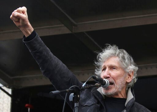 (Isabel Infantes/PA via AP). Former Pink Floyd bass player Roger Waters speaks to crowds gathered at Parliament Square in London, protesting against the imprisonment and extradition of Wikileaks founder Julian Assange  extradition, Saturday Feb. 22, 20...