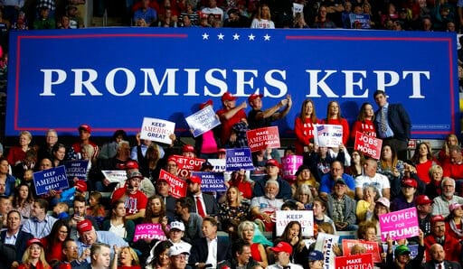 (AP Photo/Carolyn Kaster, File). FILE - In this Nov. 5, 2018, file photo, supporters of President Donald Trump wait for him to arrive to speak at a rally at Allen County War Memorial Coliseum, in Fort Wayne, Ind. Vice President Mike Pence has a favorit...