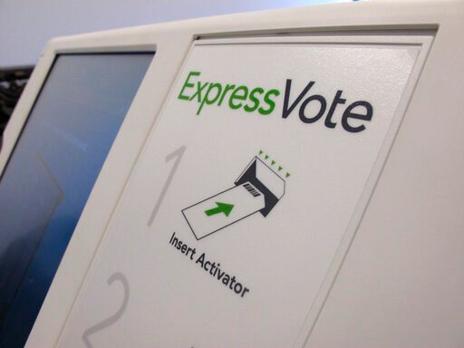(AP Photo/Allen G. Breed, File). FILE - In this Aug. 16, 2019, file photo, a digital voting machine sits on a table in Raleigh, N.C. North Carolina. In the rush to find reliable new voting machines, many state and local officials are turning to pricey ...