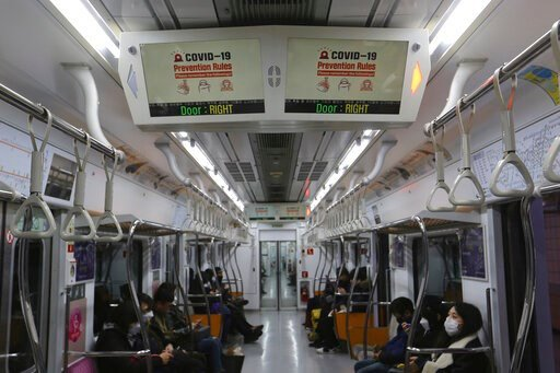 (AP Photo/Ahn Young-joon). Electric screens about precautions against the illness COVID-19 are seen in a subway train in Seoul, South Korea, Sunday, Feb. 23, 2020. South Korea's president said Sunday that he was putting his country on its highest alert...