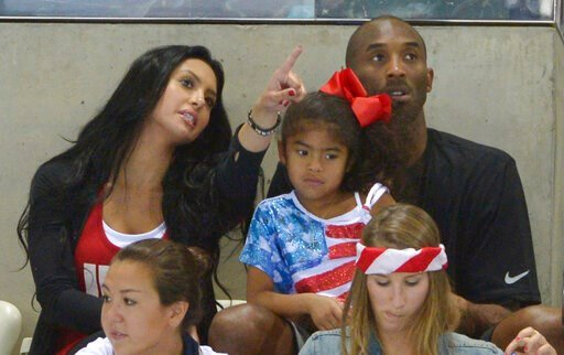 (AP Photo/Mark J. Terrill,File). FILE - In this Aug. 4, 2012 file photo Kobe Bryant with his wife Vanessa and daughter Gianna prepare to watch the final night of swimming at the Aquatics Centre in the Olympic Park during the 2012 Summer Olympics in Lon...
