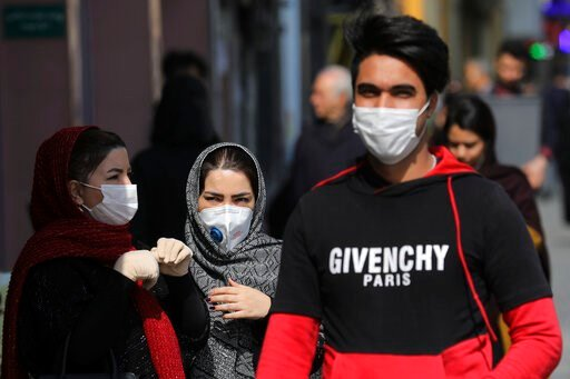(AP Photo/Ebrahim Noroozi). Pedestrians wear masks to help guard against the Coronavirus, in downtown Tehran, Iran, Sunday, Feb. 23, 2020. On Sunday Iran's health ministry raised the death toll from the new virus to 8 people in the country, amid concer...