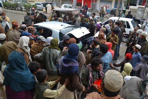 (AP Photo/Arshad Butt). Daily wage workers, jobless due to coronavirus outbreak, rush to a car to receive free food distributed in Quetta, Pakistan, Monday, March 23, 2020. The vast majority of people recover from the new coronavirus. According to the ...