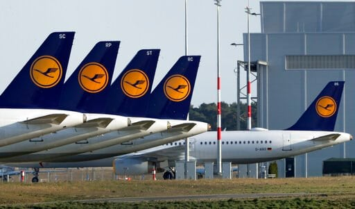 (AP Photo/Michael Sohn). Airplanes of the German airline Lufthansa are parked at the Willy Brandt Airport, Berlin Brandenburg International, in Schoenefeld near Berlin, Germany, Monday, March 23, 2020. Germany's Lufthansa said that airlines may fail wi...