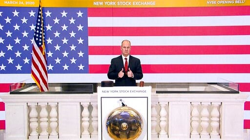 (New York Stock Exchange via AP). In this photo provided by the New York Stock Exchange, Chief Security Officer Kevin Fitzgibbons rings the opening bell of the NYSE on Tuesday, March 24, 2020. Stocks around the world rallied Tuesday amid expectations t...