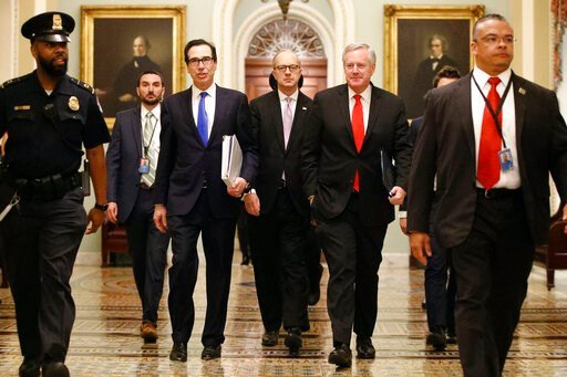 (AP Photo/Patrick Semansky). Treasury Secretary Steven Mnuchin, left, accompanied by White House Legislative Affairs Director Eric Ueland and acting White House chief of staff Mark Meadows, walks to the offices of Senate Majority Leader Mitch McConnell...