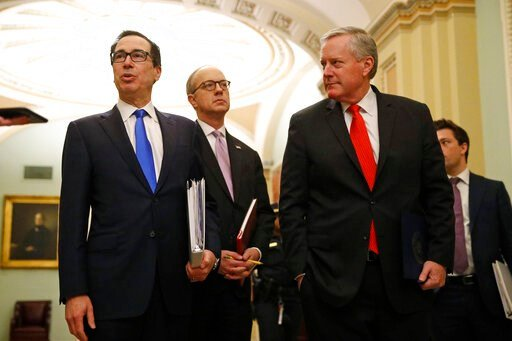 (AP Photo/Patrick Semansky). Treasury Secretary Steven Mnuchin, left, accompanied by White House Legislative Affairs Director Eric Ueland and acting White House chief of staff Mark Meadows, speaks with reporters as he walks to the offices of Senate Maj...