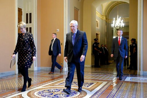 (AP Photo/Patrick Semansky). Senate Majority Leader Mitch McConnell of Ky. walks to the Senate chamber on Capitol Hill in Washington, Tuesday, March 24, 2020.
