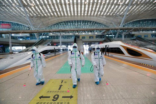 (Zhao Jun/Xinhua via AP). In this photo released by Xinhua News Agency, firefighters conduct disinfection on the platform of Wuhan Railway Station in Wuhan, central China's Hubei Province, March 24, 2020. Chinese authorities said Tuesday they will end ...