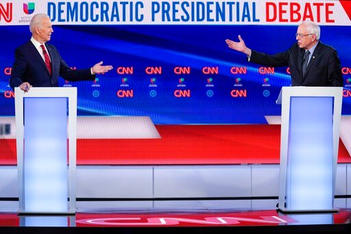 (AP Photo/Evan Vucci, File). FILE - In this March 15, 2020, file photo former Vice President Joe Biden, left, and Sen. Bernie Sanders, I-Vt., right, participate in a Democratic presidential primary debate at CNN Studios in Washington. U.S. elections ha...