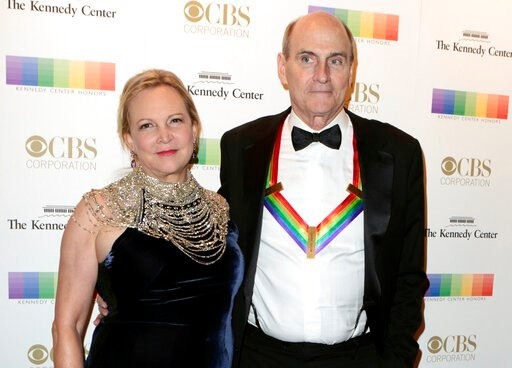 (Photo by Owen Sweeney/Invision/AP, File). FILE - In this Dec. 4, 2016 file photo, Kim Taylor, left, and her husband James Taylor appear at the 39th Annual Kennedy Center Honors in Washington, D.C. The couple have donated $1 million to Massachusetts Ge...