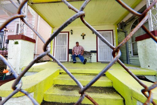 (AP Photo/Gerald Herbert). In this March 24, 2020, photo, David McGraw poses for a portrait as he sits on his front porch in New Orleans. Barely a week ago, McGraw was cooking daily for hundreds of fine diners at one of New Orleans' illustrious restaur...