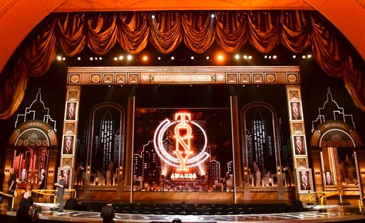 (Photo by Charles Sykes/Invision/AP, File). FILE - This June 9, 2019 file photo shows the stage prior to the start of the 73rd annual Tony Awards at Radio City Music Hall in New York. The 74th Annual Tony Awards, scheduled to air live on the CBS Televi...