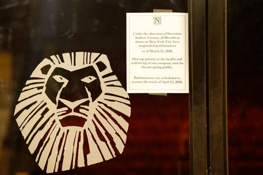 """(AP Photo/Kathy Willens). A sign announcing the suspension of all Broadway shows is posted on a door at the Minskoff Theatre, where """"The Lion King"""" had been playing, Thursday, March 12, 2020, in New York. Gov. Andrew Cuomo banned gatherings of more tha..."""