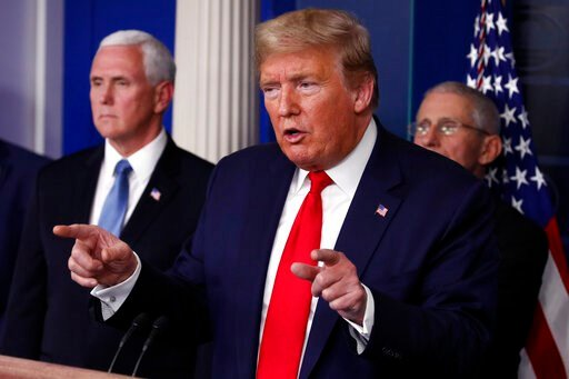 (AP Photo/Alex Brandon). President Donald Trump speaks about the coronavirus in the James Brady Briefing Room, Tuesday, March 24, 2020, in Washington, as Vice President Mike Pence and Dr. Anthony Fauci, director of the National Institute of Allergy and...