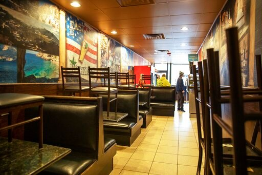 (AP Photo/David Goldman). The dining section is closed off at East Side Pockets, a small restaurant near Brown University, Wednesday, March 25, 2020, in Providence, R.I. President Donald Trump wants the country open for business by mid-April, but some ...
