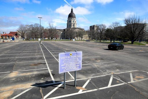 (AP Photo/Orlin Wagner). Empty parking spaces surround the Kansas Statehouse In Topeka, Kan., Wednesday, March 25, 2020. The Statehouse is closed to visitors. Shawnee County issued a stay-at-home order beginning tomorrow.