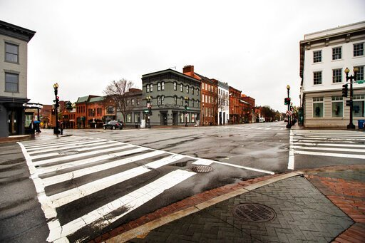 (AP Photo/Manuel Balce Ceneta). The streets in the shopping district of Georgetown are nearly empty Wednesday, March 25, 2020, in Washington. Streets are almost empty in usually crowded and busy shopping areas of the capital as Washington residents are...