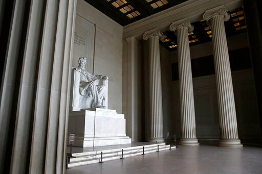 (AP Photo/Patrick Semansky). The Lincoln Memorial sits empty in Washington, Wednesday, March 25, 2020. Officials have urged Washington residents to stay home to contain the spread of the coronavirus.