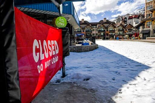 (AP Photo/Michael Ciaglo). This Tuesday, March 24, 2020, photo shows a closed ski lift in Vail, Colo., after Vail Ski Resort closed for the season amid the COVID-19 pandemic. Ski resorts across the West that were shut down amid coronavirus fears are gr...