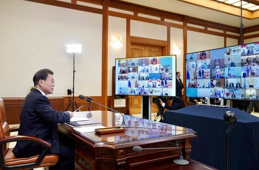 (South Korea Presidential Blue House/Yonhap via AP). In this photo provided by South Korea Presidential Blue House via Yonhap News Agency, South Korean President Moon Jae-in attends G-20 virtual summit to discuss the coronavirus disease outbreak at the...