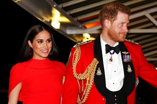 (Simon Dawson/Pool via AP, file). FILE - In this Saturday March 7, 2020 file photo, Britain's Prince Harry and Meghan, Duchess of Sussex arrive at the Royal Albert Hall in London. Meghan, Duchess of Sussex has her first post-royal job: narrating a Disn...