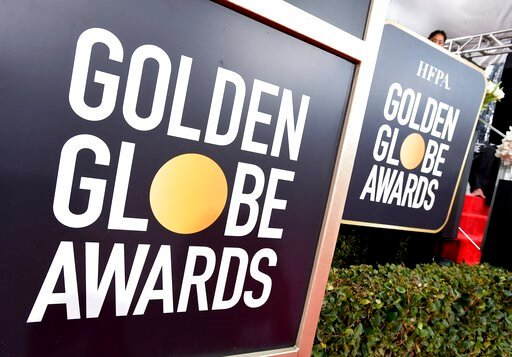 (Photo by Jordan Strauss/Invision/AP, File). FILE - This Jan. 6, 2019 file photo shows Golden Globes signage on the red carpet at the 76th annual Golden Globe Awards in Beverly Hills, Calif. The Golden Globes will accept movies submissions without a th...