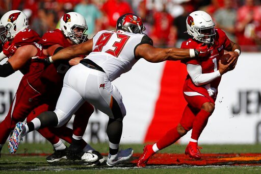 (AP Photo/Jeff Haynes, File). FILE - In this Nov. 10, 2019, file photo, Tampa Bay Buccaneers nose tackle Ndamukong Suh (93) brings down Arizona Cardinals quarterback Kyler Murray (1) during an NFL football game in Tampa, Fla. The Buccaneers announced T...