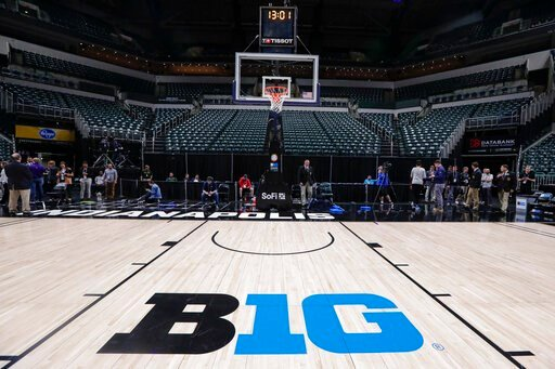 (AP Photo/Michael Conroy). The seating area at Bankers Life Fieldhouse is empty as media and staff mill about, Thursday, March 12, 2020, in Indianapolis, after the Big Ten Conference announced that remainder of the men's NCAA college basketball games t...
