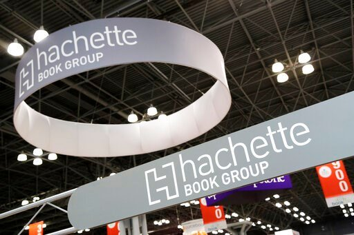 (AP Photo/Mark Lennihan, File). FILE - This May 28, 2015 file photo shows signs for Hachette Book Group displayed at BookExpo America in New York. Publishing's annual national convention, BookExpo, has been postponed until July. Organizers cited concer...