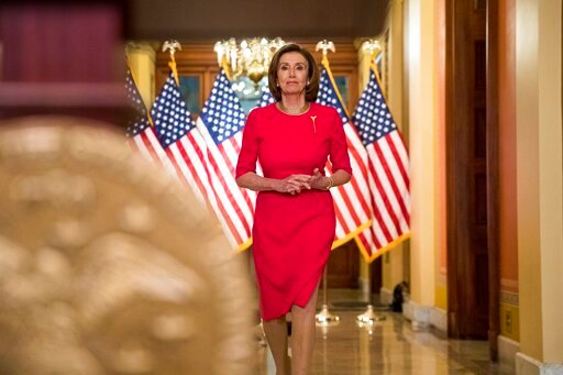 (AP Photo/Andrew Harnik, Pool). House Speaker Nancy Pelosi of Calif. arrives to read a statement outside her office on Capitol Hill, Monday, March 23, 2020, in Washington.